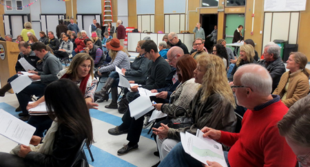 Scores of residents turn out this week at a town hall meeting to voice concerns over rehab facilities in their neighborhoods. Photo by Marilynn Young