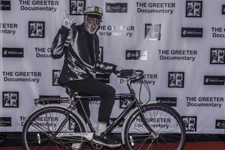 """The town's most recent greeter, Michael Minutely, attends the premier of """"The Greeter Documentary."""""""