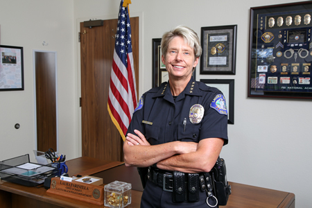 Police Chief Laura farina's reorganization plan, including new hires, won approval.