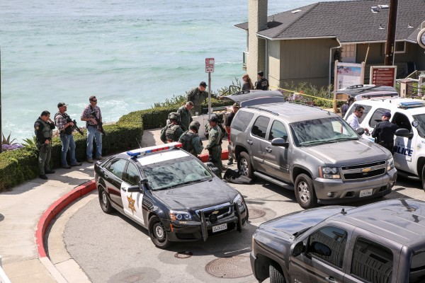 Police took over the Cress Street beach access for a command post during a toxin scare.