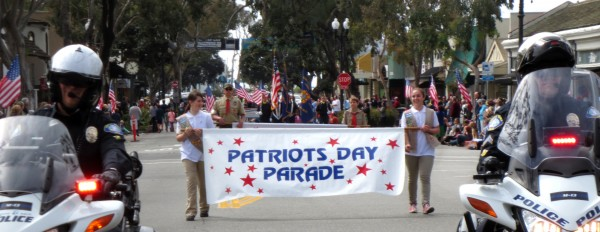 Girl Scouts with Laguna Beach Police Motor Escort lead the start of the 50th Patriots Day Parade March 5.