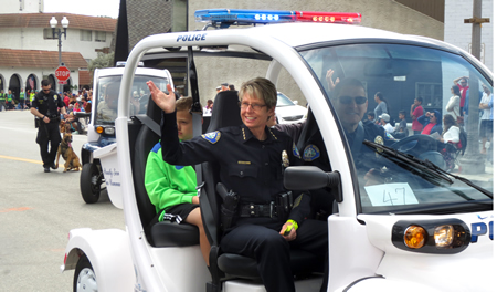 Laguna Beach Police Chief Laura Farinella takes to the streets. The K-9 police dog Ranger can be seen in the background.