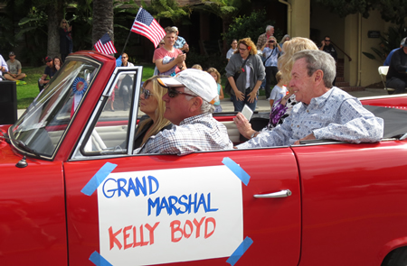 Grand Marshal Kelly Boyd (right) led the 50th Patriots Day Parade.