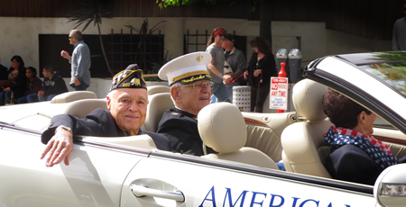 Retired Marine Lt. Col. Carlos McAfee, 82, (left) was the honored patriot celebrated by parade organizers.