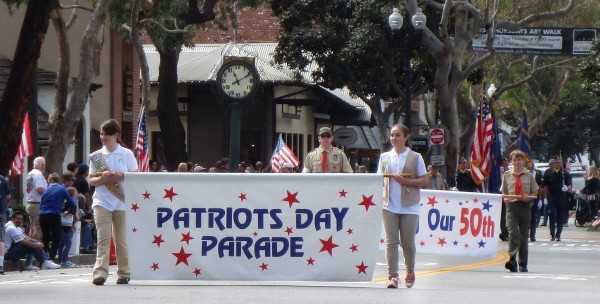 Girl Scouts lead the Laguna Beach 50th Patriots Day Parade on Forest Ave. on March 5, 2016.