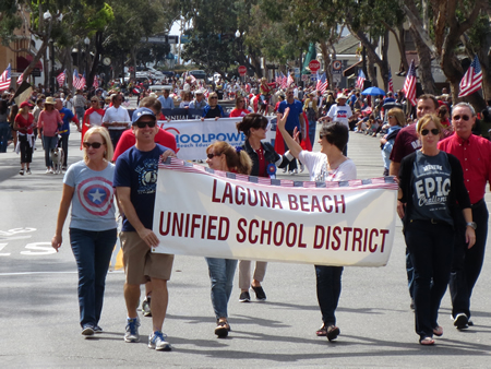 Laguna Beach Unified School District top administrators and board members march in the parade, followed by Schoolpower supporters.