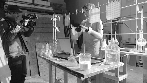 "Kirkley shooting at a drug-lab set with musician Matt Costa depicting an LSD lab tech. Costa also composed the ""Orange Sunshine"" soundtrack."