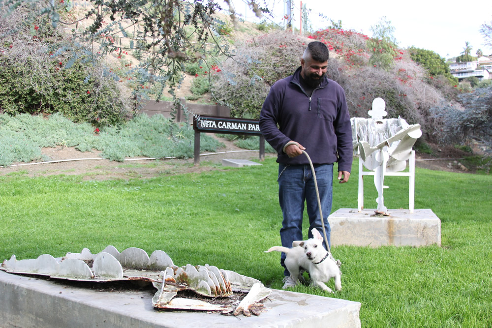 Ray Jovee and his terrier Whiplash visit Nita Carmen Park daily. In January, Jovee was considering restoring the sculpture himself. Photo by Andrea Adelson.