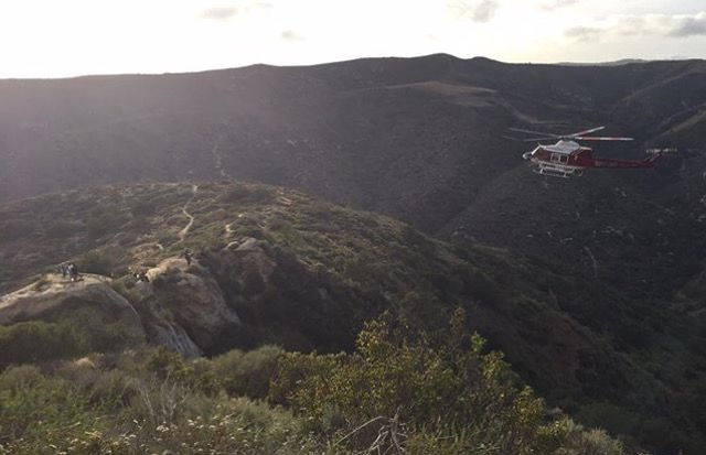 Orange County Fire Authority airlifted Hukill up from the canyon floor as mountain bikers watched with concern. Photo by Jon Duncan.