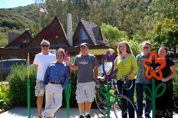 A new bike rack sprouts in Laguna Canyon thanks to, from left, Billy Fried, Mayor Steve Dicterow, Chris Prelitz, artist Liz Avalon, Sawdust President Jay Grant, and the city's cultural arts manager, Sian Poeschl. A new bike rack sprouts in Laguna Canyon thanks to, from left, Billy Fried, Mayor Steve Dicterow, Chris Prelitz, artist Liz Avalon, Sawdust President Jay Grant, and the city's cultural arts manager, Sian Poeschl.  A new bike rack sprouts in Laguna Canyon thanks to, from left, Billy Fried, Mayor Steve Dicterow, Chris Prelitz, artist Liz Avalon, Sawdust President Jay Grant, and the city's cultural arts manager, Sian Poeschl. A new bike rack sprouts in Laguna Canyon thanks to, from left. Billy Fried, Mayor Steve Dicterow, Chris Prelitz, artist Liz Avalon, Sawdust President Jay Grant, and the city's cultural arts manager, Sian Poeschl.