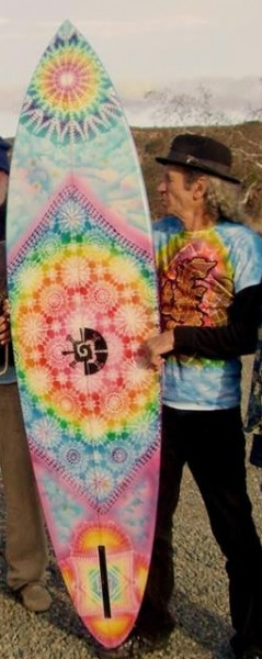 "In an image from the film, Laguna Beach artist ""Starman"" Star Shields with a surfboard he airbrushed for the Brotherhood of Eternal Love, which used surfboards to smuggle hashish. Photo courtesy Star Shields:"