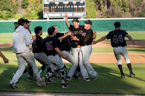 Will McInerny, with hand raised, is mobbed by his teammates after securing the final out on a strikeout Saturday, May 28. Photo by Anna Goddard