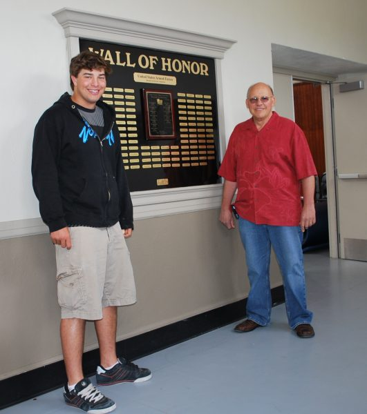 Crafted by Eagle Scout Nate Wilson, left, and conceived largely by high school math teacher Walt Hamera, the Wall of Honor in the high school's North Gym (half of which is shown here) was dedicated in May 2009.