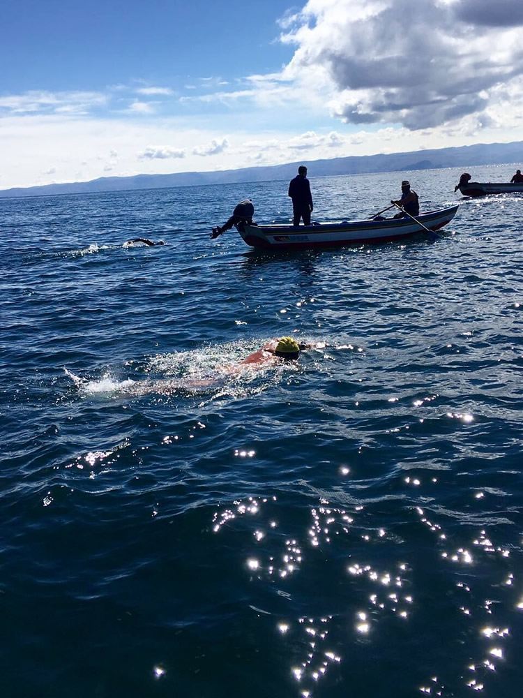 Local Tom Hale, in yellow cap, competes far from home last week, swimming between islands in Lake Titicaca in Peru.