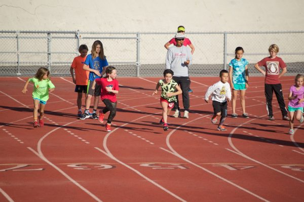 Coach Fred Pichay puts team members through their paces in preparation for the Orange County meet. Photo by Marc Ostrick.