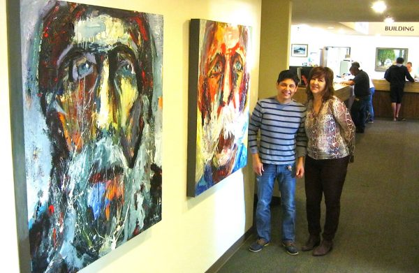 Artists Hugo Rivera and Wendy Wirth inside the City Hall exhibit.