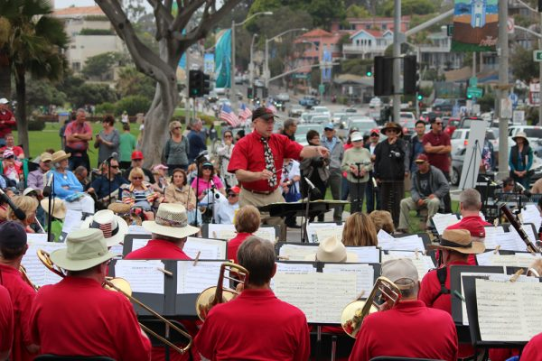 Expect a crowd on Main Beach with their back to the water at midday on Memorial Day, listening to the 60-strong Laguna Concert Band performance..