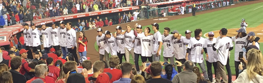 "Laguna Beach High School's CIF Champion baseball team sings ""Take Me Out to the Ball Game"" during the seventh-inning stretch at the Angels-Twins game on Tuesday, June 14. Photo by Frank Aronoff."