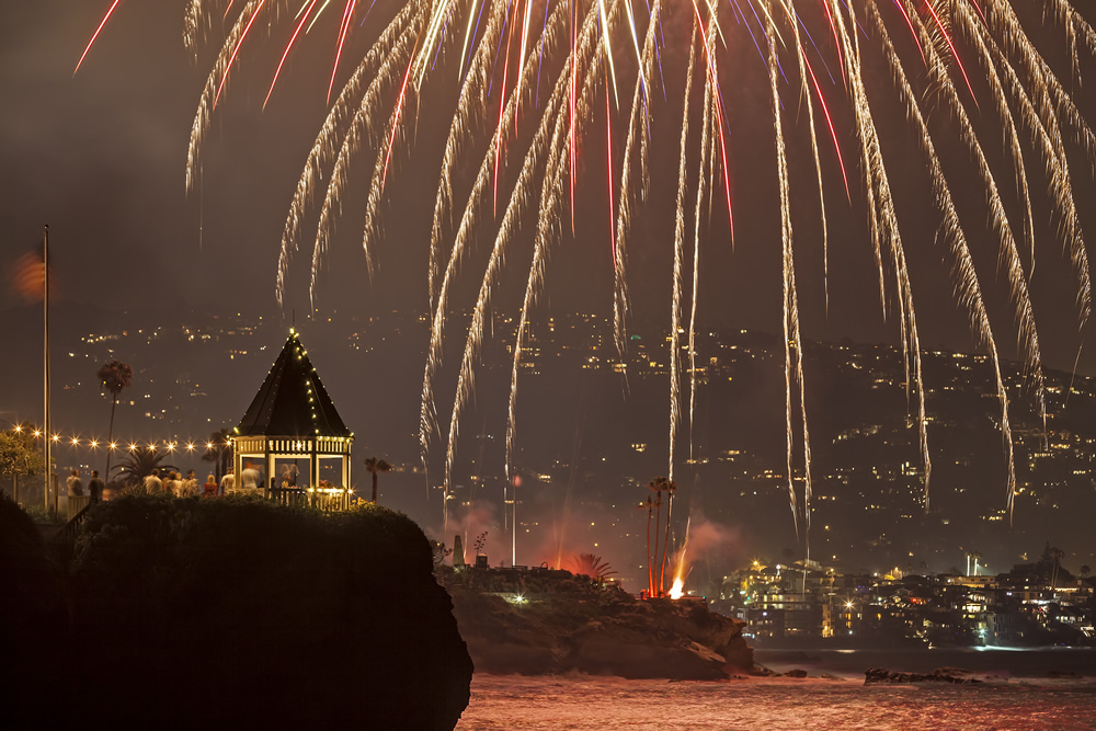 Independence Day in Laguna Beach glitters with fireworks, but also an aerial show, sunbathers galore and neighborhood traditions. See more images in Limelight. Photo by Mitch Ridder.