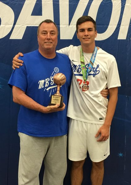 Barry Greenough, left, with is dad, Jeff, with the third place trophy and medal from the 18-open division. Greenough's Manhattan Beach squad finish third in the top division of the Junior Olympics. Greenough returns to Laguna for his senior season next spring.