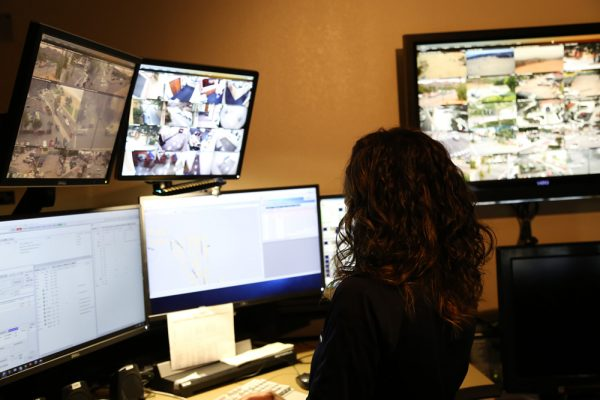 Dispatcher Jennifer Querry fields calls and monitors the city's camera system from the police department. Ten new cameras will bring the total to 23 surveillance cameras. Photo courtesy of LB Police Dept.