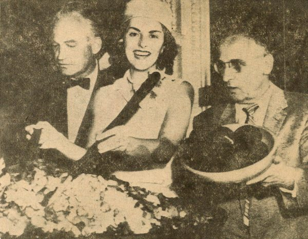 "Rep. James B. Utt, right, with the bowl of avocados he contributed to the ""Senate salad"" dished out in 1957 alongside Mrs. Lynwood Findley, of Arlington, Va., Mrs. America 1958, and Senator Barry Goldwater. Photo from the O.C. Register."