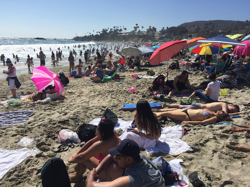 Crowds estimated by lifeguards at 60,000 a day swarmed the sands over the three-day weekend. Photo by charlie craig.