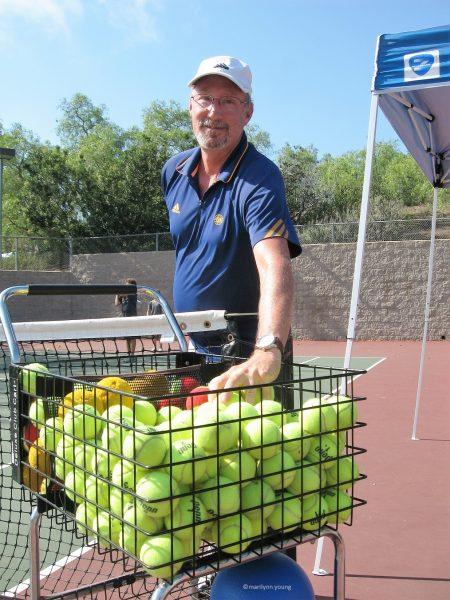 Tennis coach Garry Glaub readies for his final lesson in Laguna Beach.