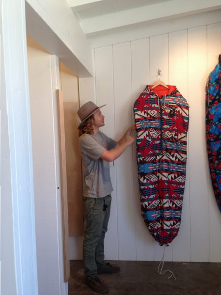 """Poler Laguna manager Brandon Smith with the company's signature product, the """"napsack."""""""