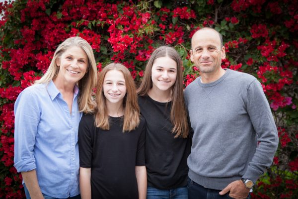 Peggy Wolff, left, with her husband Josh and their two daughters, Kenzie and Shelby.