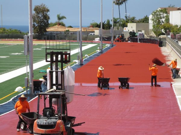 Workers finishing the Laguna Beach High School field, which closed in May for a multi-million dollar makeover. It reopens next week. photo by marilynn Young.