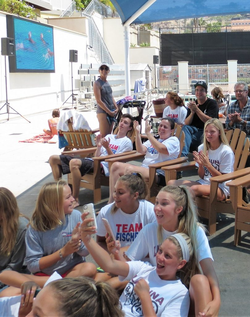 Team Fischer gathered at the high school pool to share the experience of watching two Laguna Beach girls on the US women's water polo team compete in the gold medal round in Brazil..