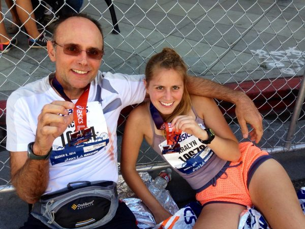 Michael Cook and his daughter Aralyn finish a marathon together in 2014.