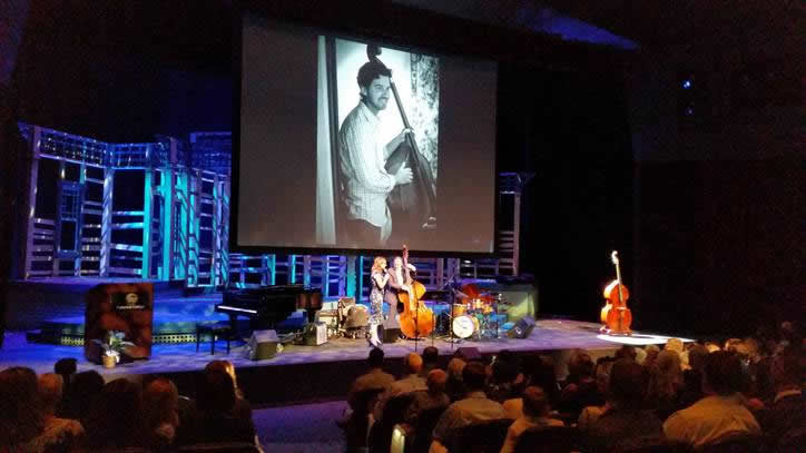 Jazz bassist and teacher Roger Shew was remembered for his effortless empathy and love for pranks at a memorial service Sunday, Sept. 25, where his wife, Jamie, sang and a photo slide show revealed a rich family life around their son, Simon. Music and educator colleagues, students and friends, and a large contingent of Laguna Beach parents, filled the 500-seat Fullerton College theater and together released balloons in a colorful tribute. Photo by Charles Michael Murray.