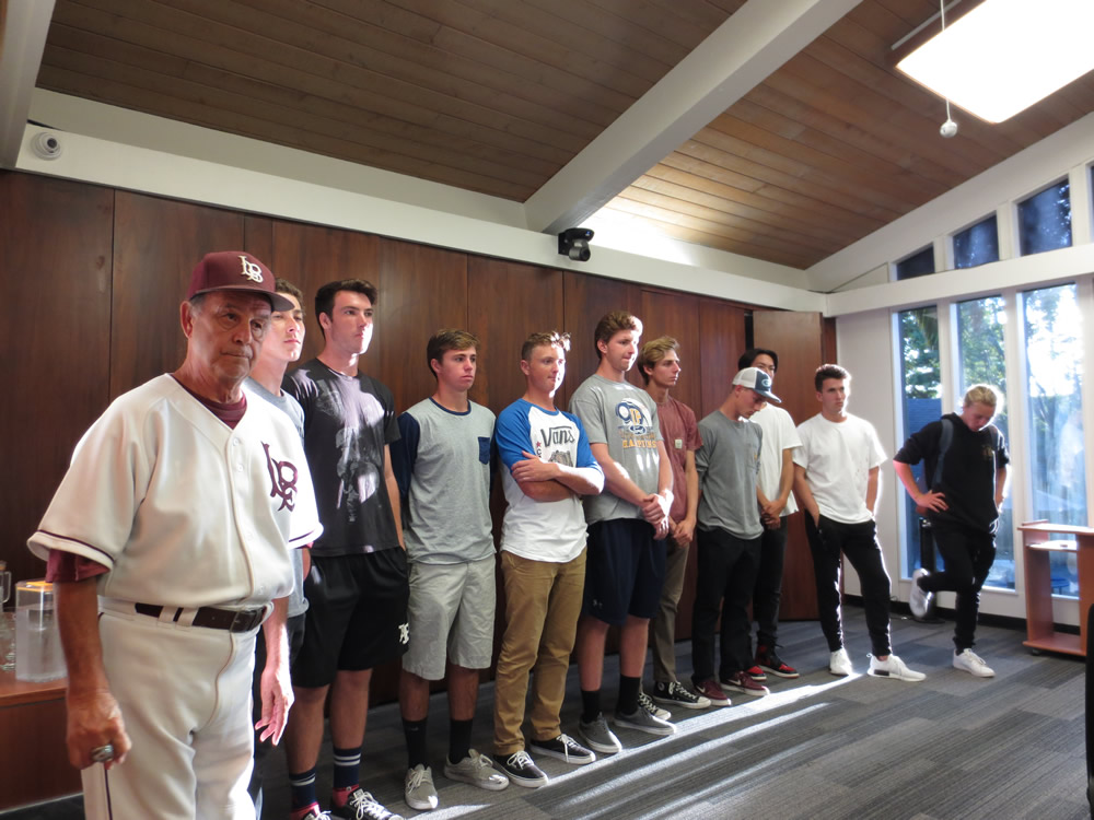 A portion of the Laguna Beach High School baseball and their coach earned the delayed applause of the school board at its meeting Sept. 13. The team won the school's first ever CIF Southern Section Division 4 championship in June. Team assistant Skipper Carrillo, left, participates. Photograph by Marilynn Young