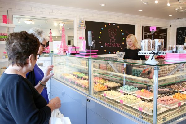 Joanna Tomasik, who owns Le Macaron with her husband Cyrille Lemoine, greets customers in the newly opened shop. Photo by Jody Tiongco.