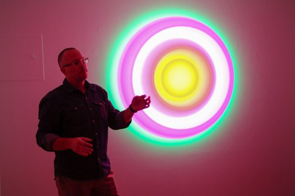 Artist Phillip K. Smith III describes one of his works. Photos by Jody Tiongco.