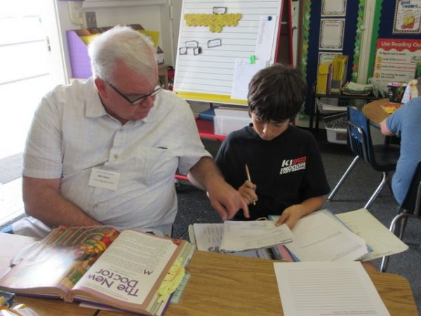 A Learning Club volunteer assists an El Morro student