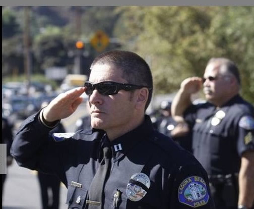 Captain Darin Lenyi joins the entire Laguna Beach department in 2013 in honoring Officer Jon Coutchie, who died in a traffic collision.