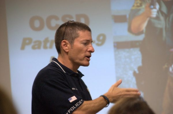 Captain Darin Lenyi also helps train prospective officers at a police academy.