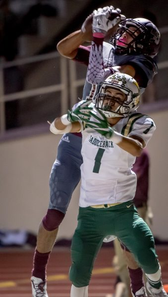 Laguna's No. 1 Adam Armstrong goes high over Saddleback's No. 1 Enrique Hernandez to snag a Cutis Harrison pass for Laguna's first touchdown to go ahead of Saddleback 7 to 6. Laguna never lost the lead.