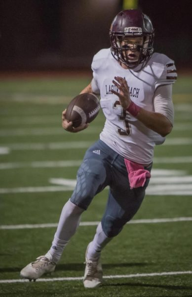 Quarterback Curtis Harrison ran for 111 yards and passed for 53 yards in an overwhelming victory against Costa Mesa.