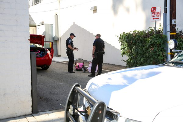 Police question the teen mother and passenger in a stolen car on Tuesday, Oct. 25. Photo by Jody Tiongco.