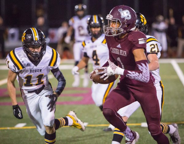 Adam Armstrong runs after a Curtis Harrison pass in the first half.  Laguna would not score until its first drive of the second half. Photos by Doug Landrum