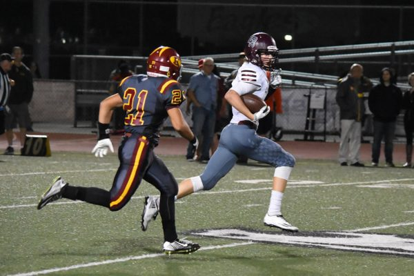 Sean Nolan outruns Estancia's defense. Photo courtesy of LBHS Breaker football.