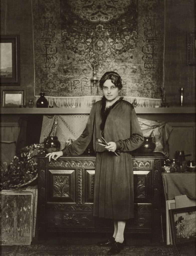 A portrait of Anna Hills, probably in her home-studio, the subject of a Laguna Art Museum retrospective. Photo by George Hurrell