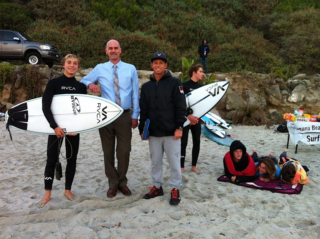 Principal Chris Herzfeld checks out the LBHS surf team in the field.