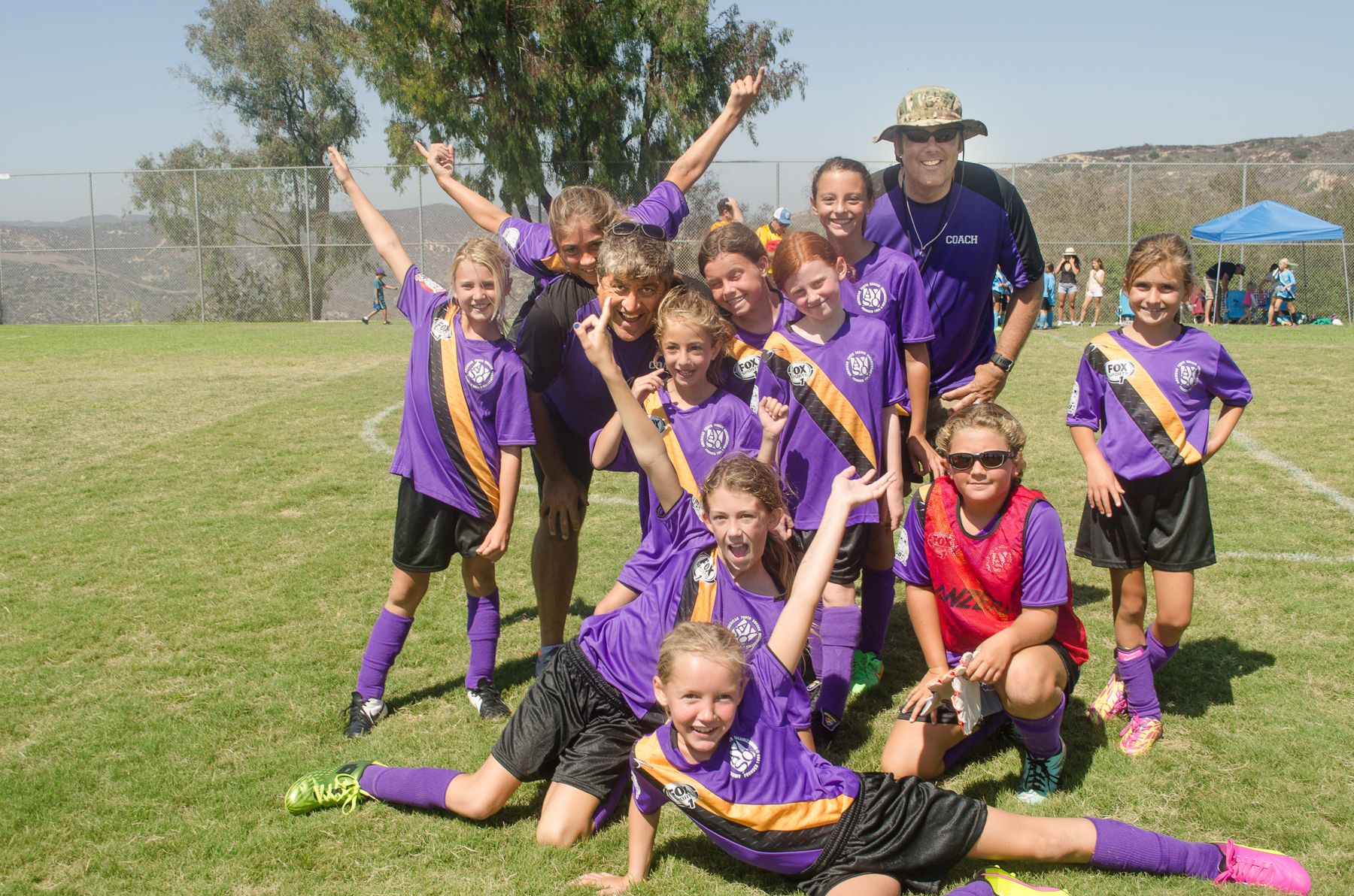 Thunder Waves, an under 10 AYSO team, celebrate their first place win in the regular season. From left, Ava Steris, Siena Jumani, Coach David Jumani, Maris Morgan, Izzy Gray, Alexa Sarkisian, Hadley Hunt, Allie Nottage, Marlena Steinbach, Natalie Boyd, Coach Chris Boyd and Sophia Billy