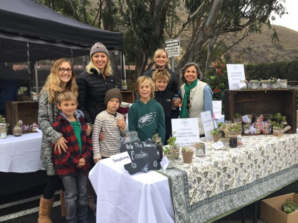 From left, parents Deborah Johansson, Nicole McMann, Laura Sauers and Gerri Machin with  Magnus Johansson, Hendricks McMann, Callum Murray and Max Sauers, fundraising at their farmers market booth.