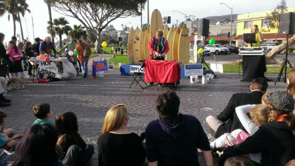 A magic act precedes lighting the surfboard menorah on Sunday, Dec. 25.